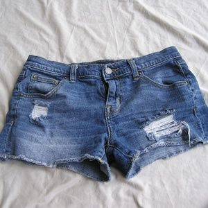 Ripped blue jean boy friend shorts in womens